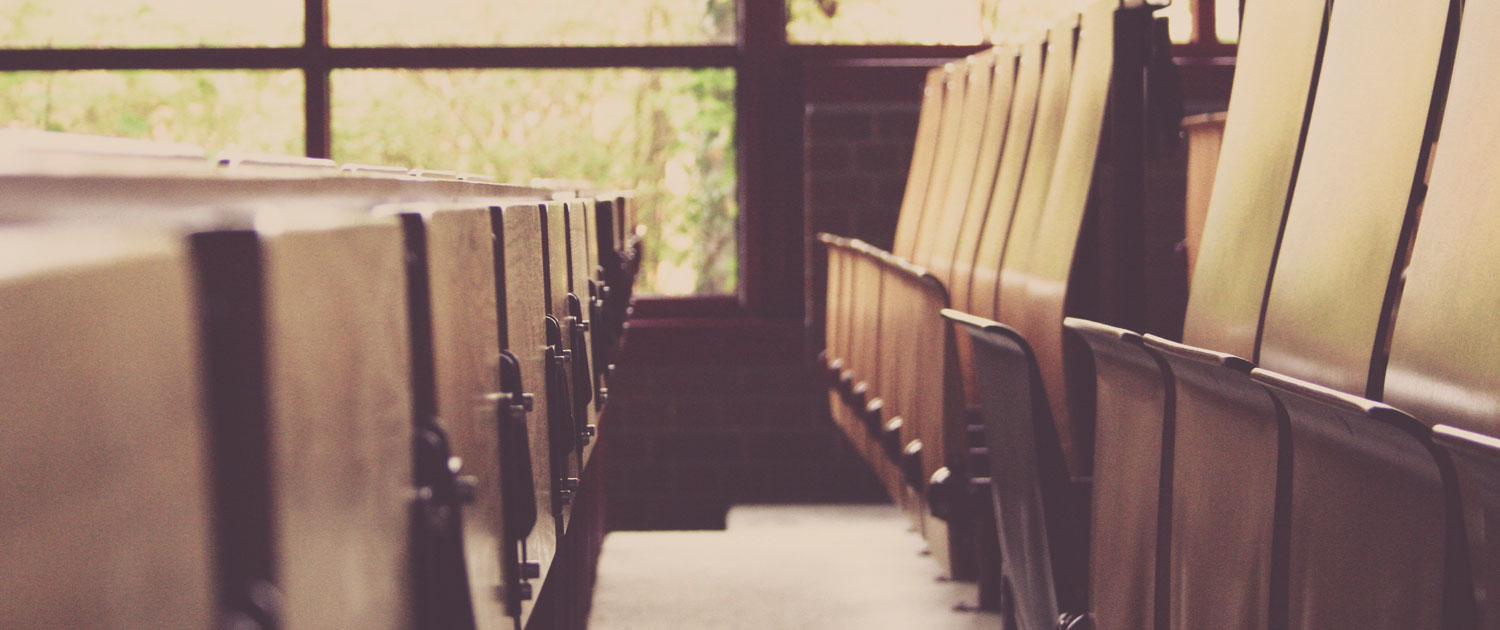 A photograph of chairs in a university lecture hall