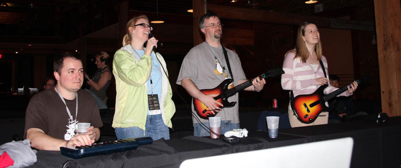 People playing Rockband at PHP Community Conference
